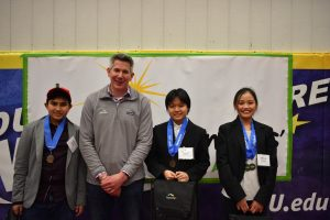 Mike Morris with the winners of the Topcoder award at the Young Inventors Program