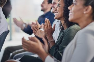 young woman applauds masterclass at TCo19